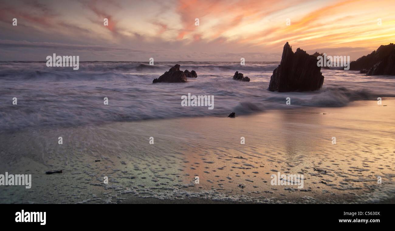 Sunset over Westcombe Beach, South Devon, England UK - Stock Image
