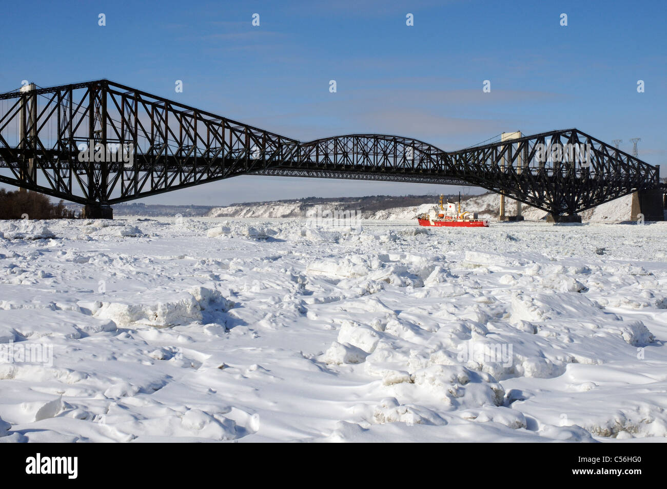 the-frozen-river-st-lawrence-and-the-pont-de-quebec-quebec-city-canada-C56HG0.jpg