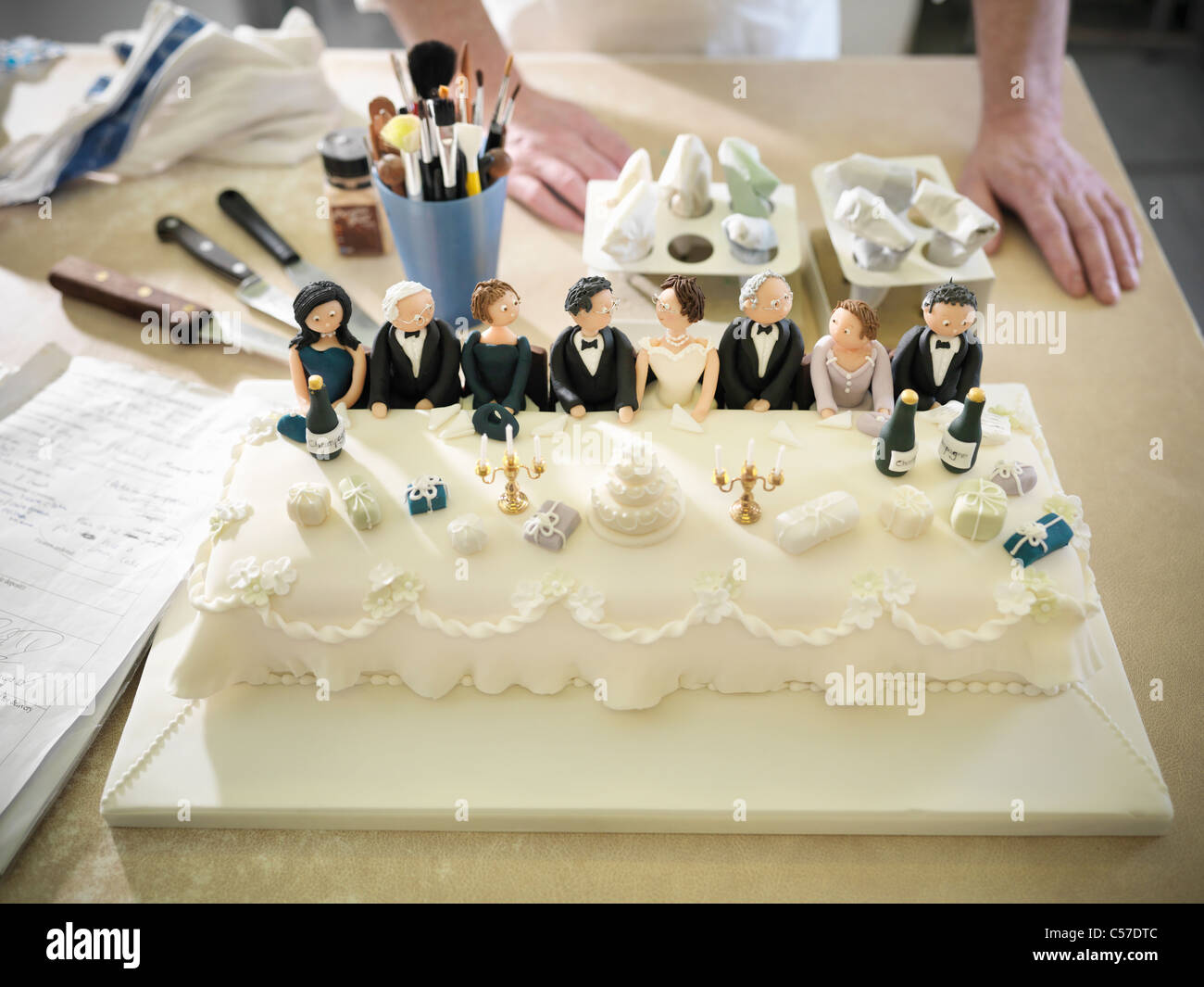 Wedding cake with top table decorations - Stock Image