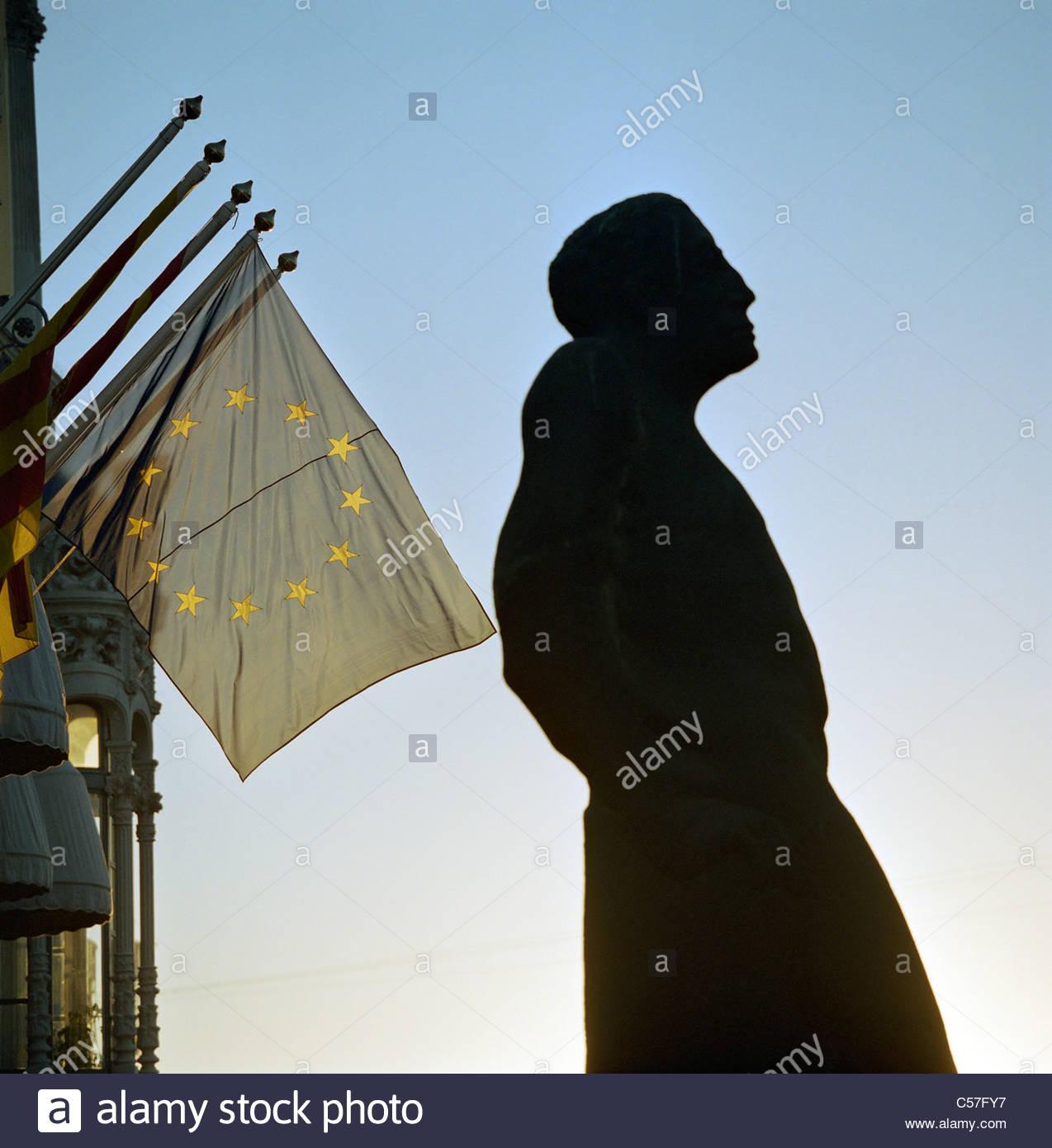 Statue with European Union flag - Stock Image