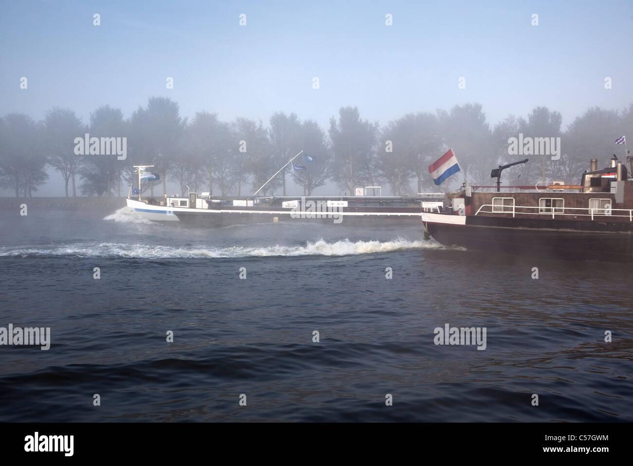 The Netherlands, Nigtevecht, Cargo ships on canal called Amsterdam Rijn Kanaal. - Stock Image