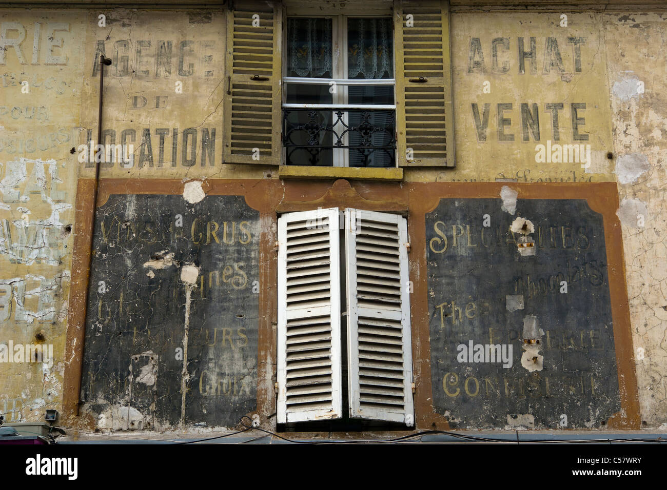 Old advertising on the front of a house at L'Isle-Adam, Val d'Oise France - Stock Image