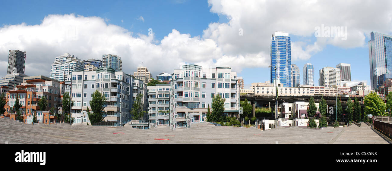 City skyline of buildings downtown along the pier with a great diversity of buildings - Stock Image