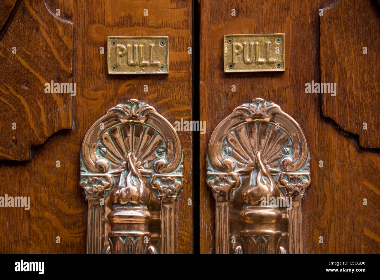 Wooden doors to the London Coliseum Theatre opera house, St Martins Lane, City of Westminster, London WC2, England, Stock Photo