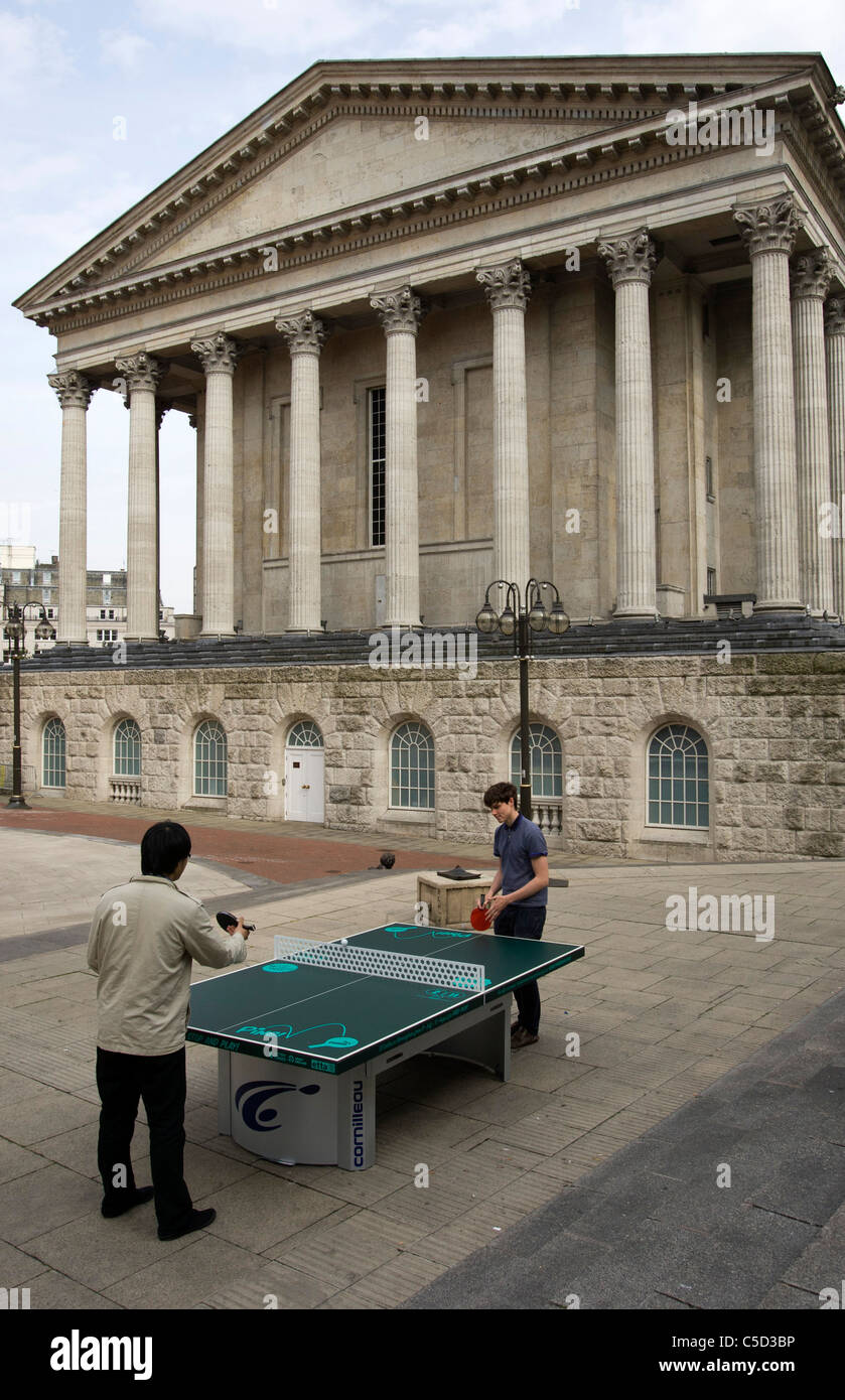 People playing ping pong in Chamberlain Square Birmingham. Over 50 ping pong tables were set up in various locations. - Stock Image