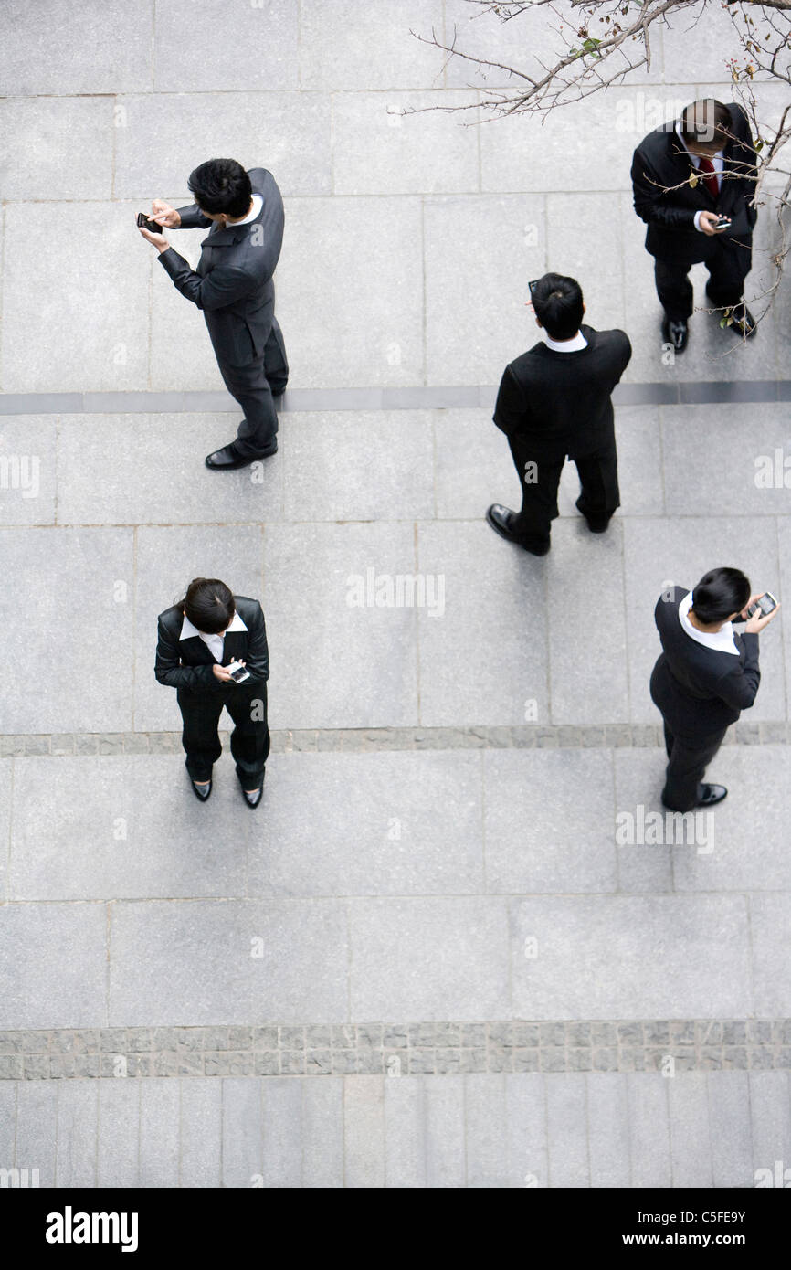 Businessmen using cellphones - Stock Image