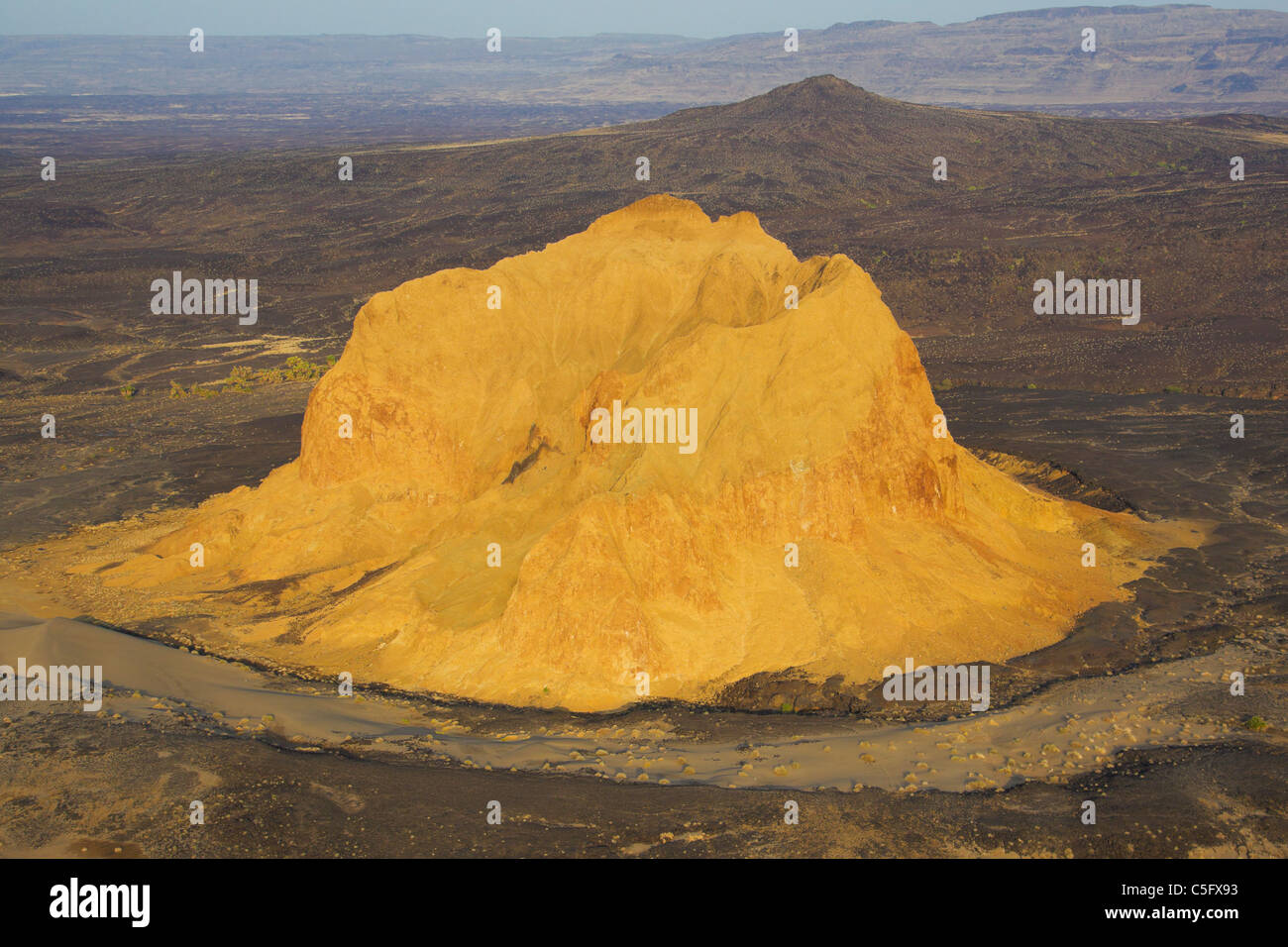 A crumbling extinct volcano, which is known as Aruba Rock - Stock Image