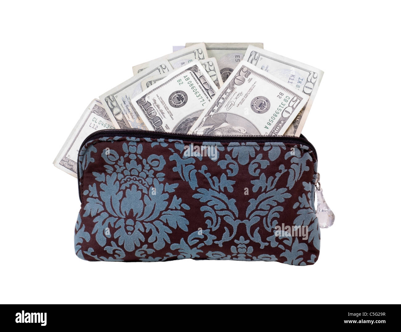 Mad money in the form of many large bills in a small handbag - path included - Stock Image