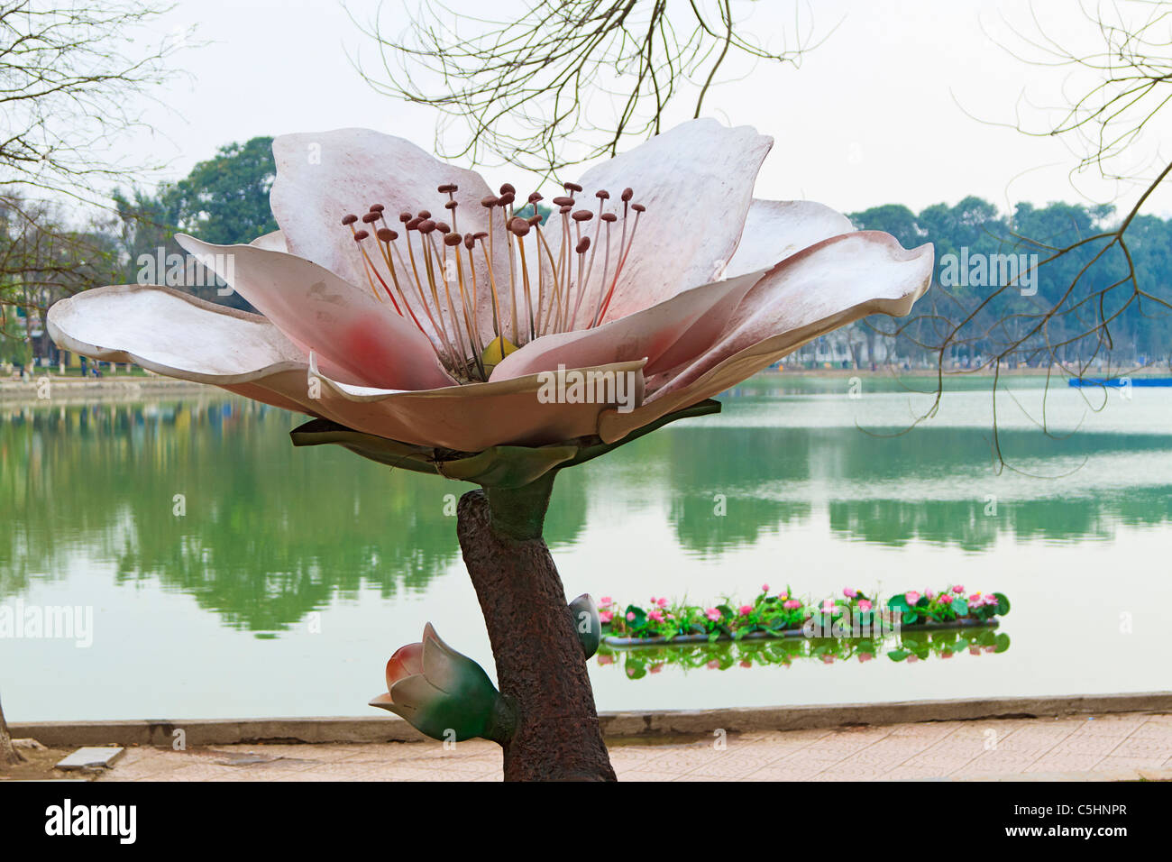 Large Statue Of Lotus Flower With Real Lotus Flowers On A Floating