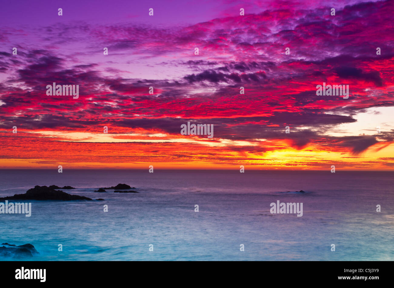 Sunset over the Pacific Ocean, Point Lobos State Reserve, Carmel, California - Stock Image