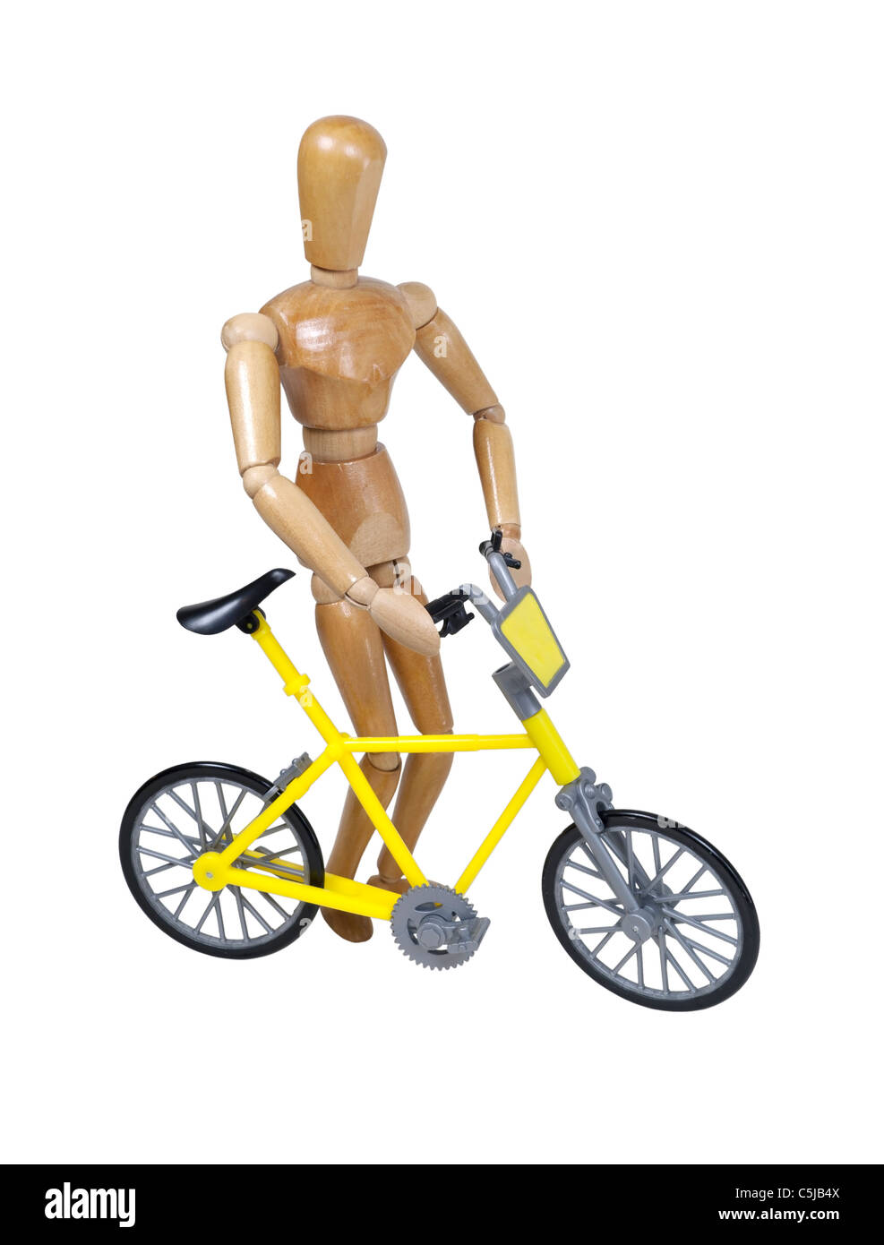 Walking a yellow bicycle used as a personal transportation device - path included - Stock Image