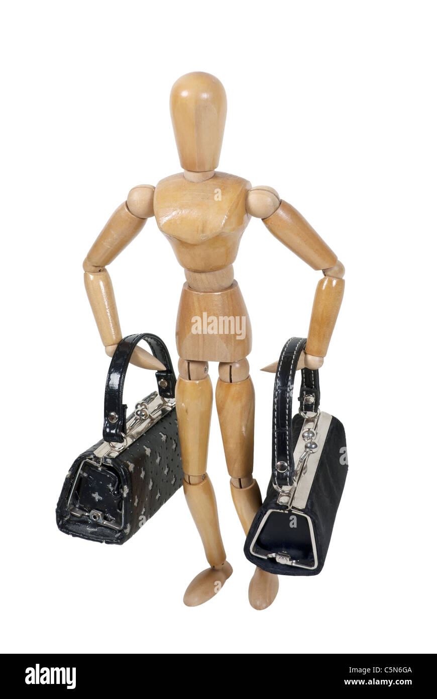 Wooden model carrying black bags of luggage for traveling - path included - Stock Image