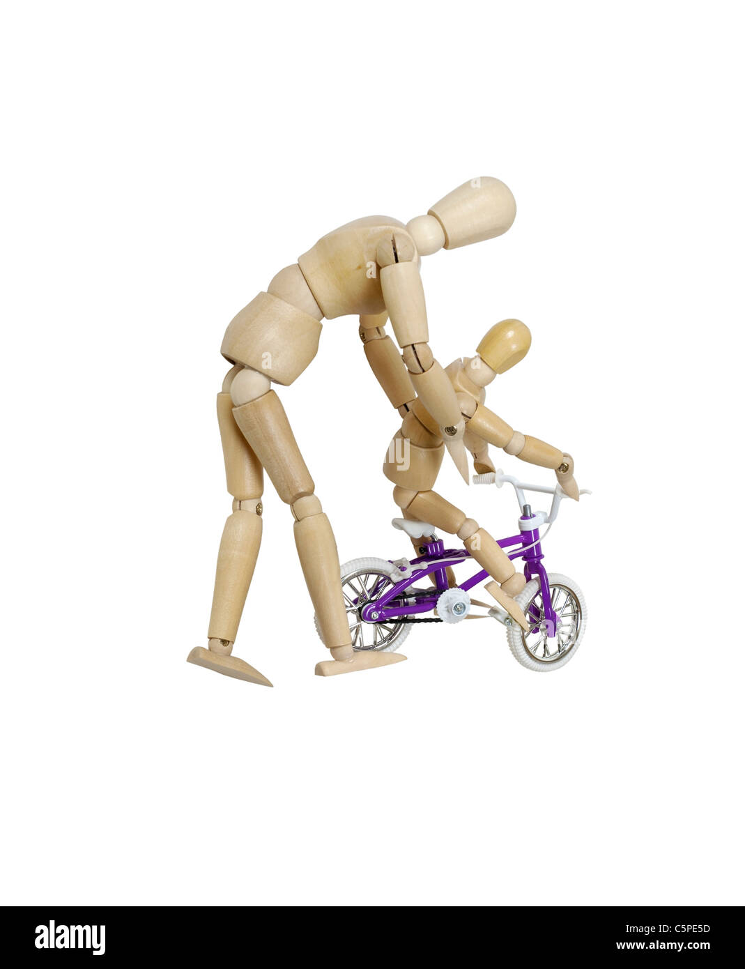 Parent teaching their child how to ride a bicycle - Path included - Stock Image