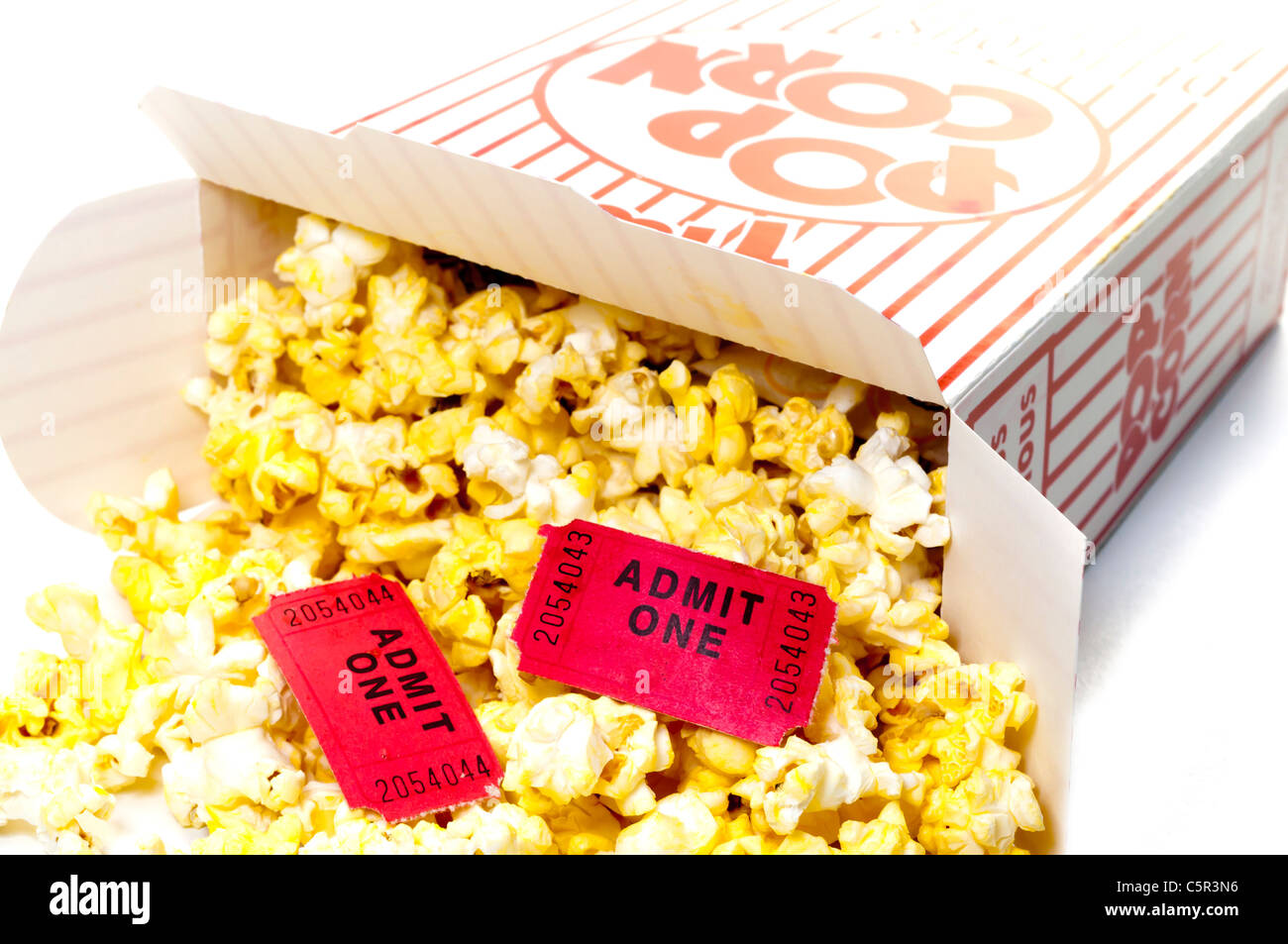 Popcorn and Movie Tickets Isolated Closeup - Stock Image