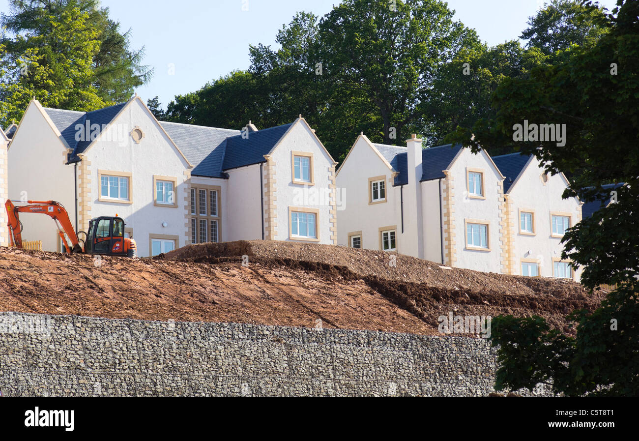 Attractive Executive Homes Built On A Steep Hillside, With Gabion Walls Holding Back  New Subsoil To