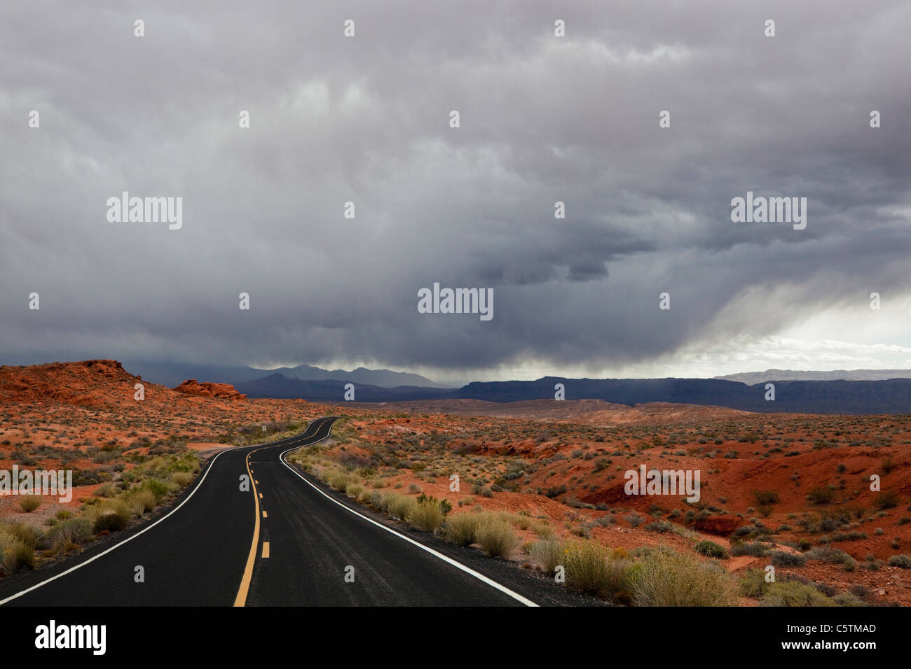 USA, Nevada, Valley of Fire State Park, Empty road - Stock Image