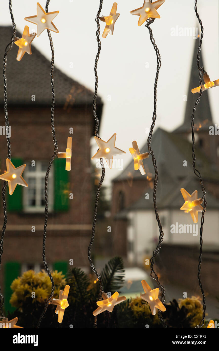 Germany, Cologne, Close up of illuminated stars as christmas window decoration - Stock Image