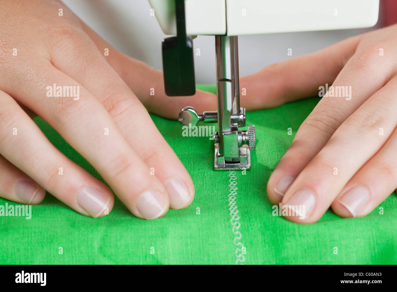 USA, Illinois, Metamora, close-up of woman sewing - Stock Image