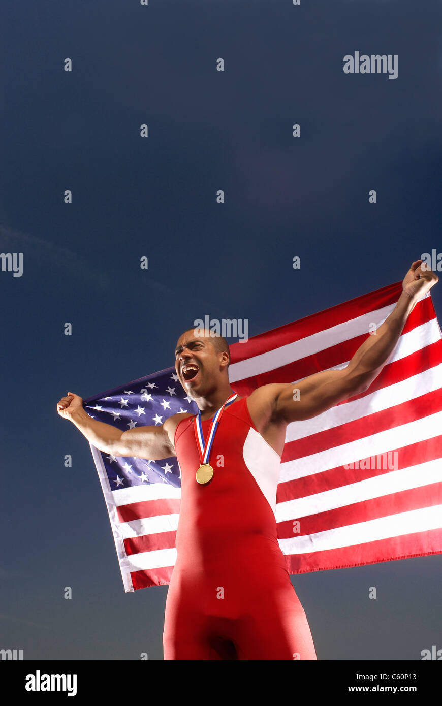 Athlete with medal and American flag - Stock Image