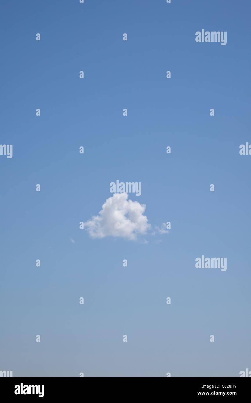 lone cloud in sky - Stock Image