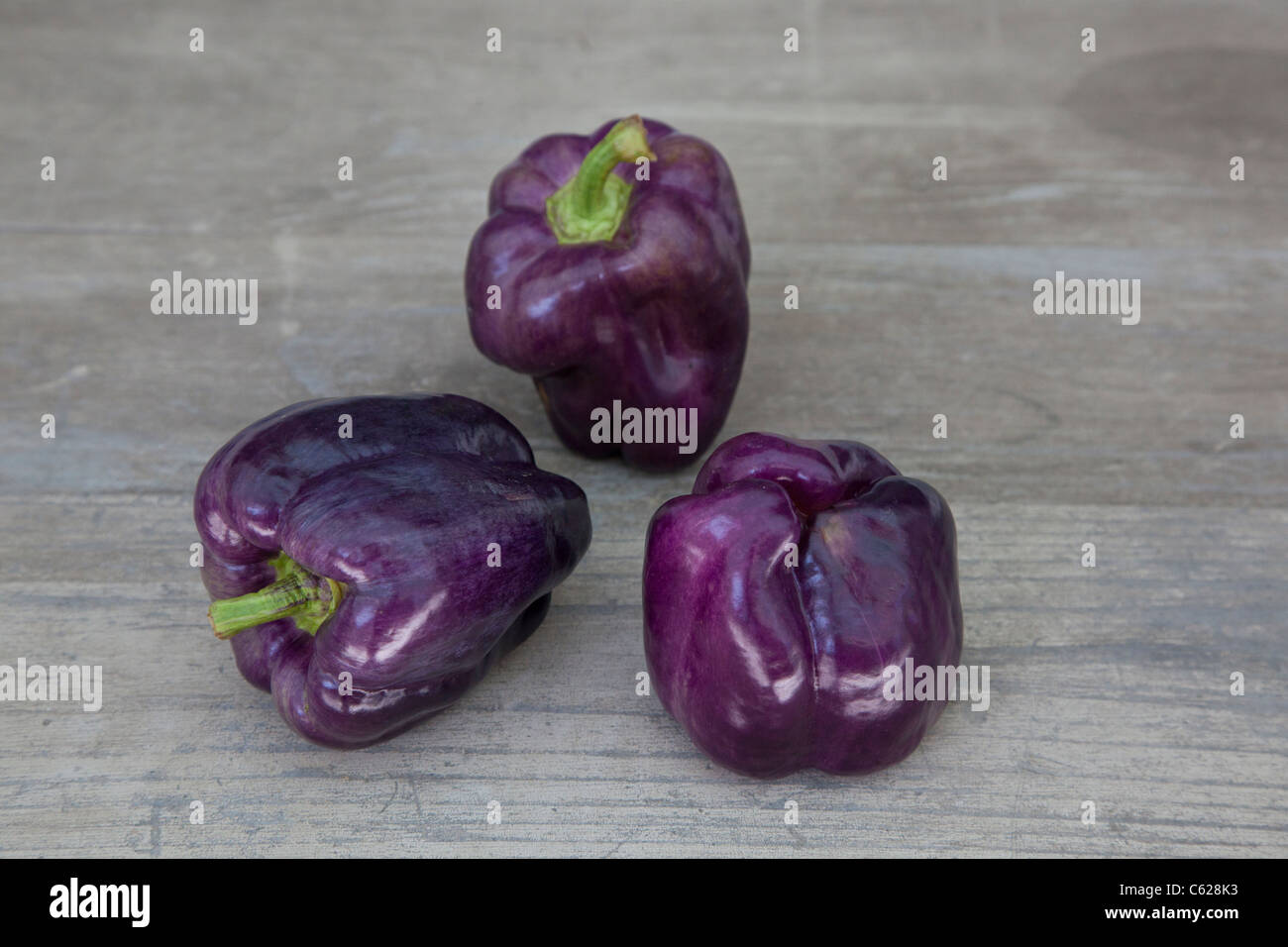 purple sweet peppers - Stock Image