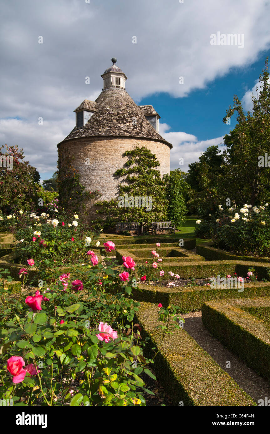 The Pigeon House, built in 1685, stands amongst the roses and box ...