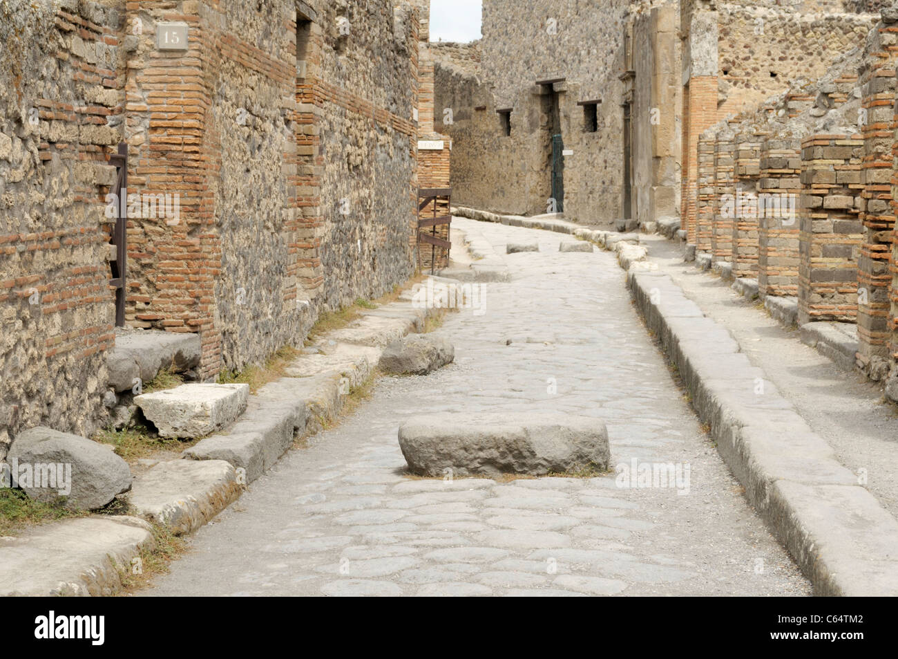 Pompeii ancient street, with block for stepping across - Stock Image