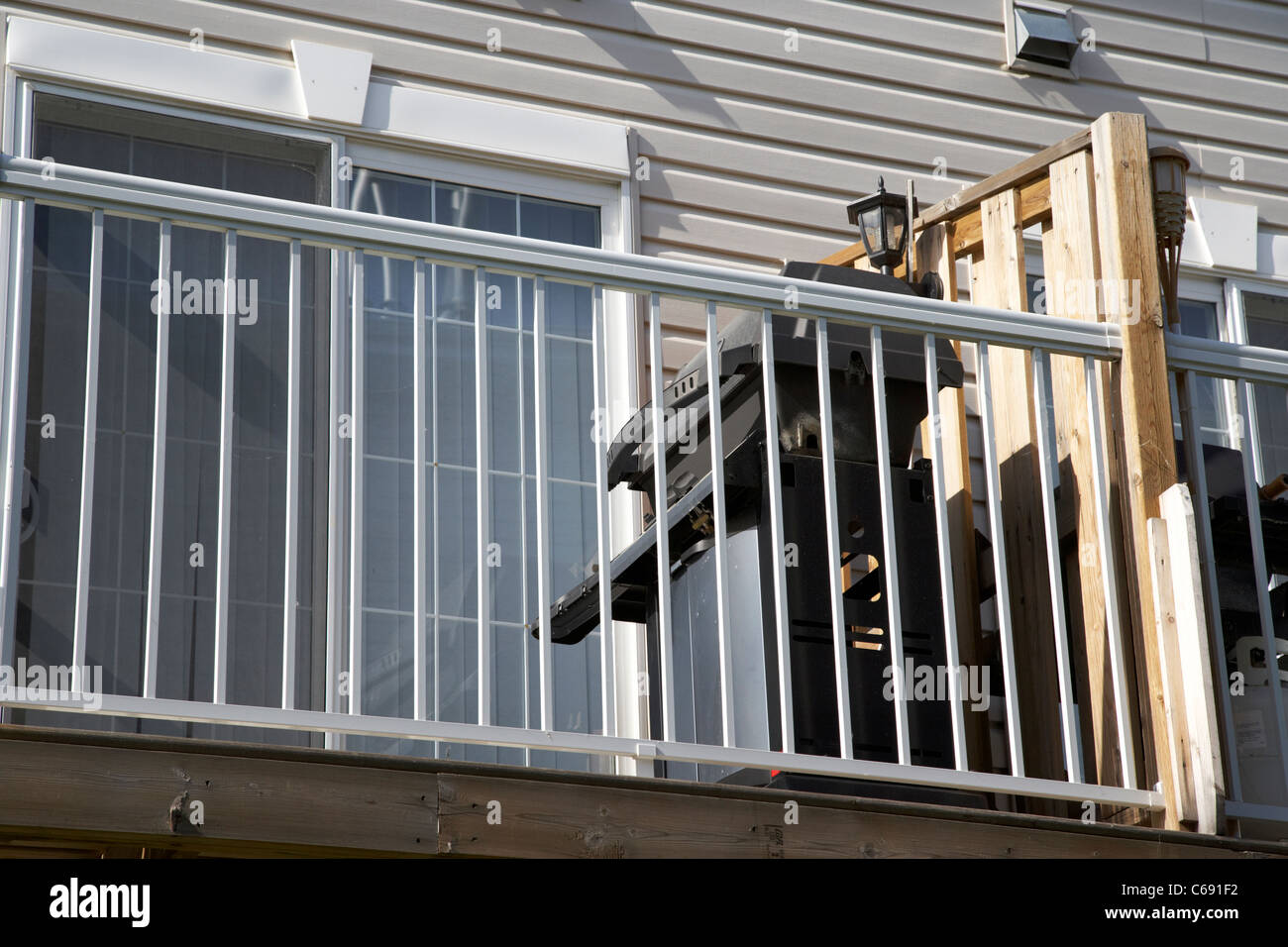 gas bbq on balcony of townhouse in Saskatoon Saskatchewan Canada - Stock Image