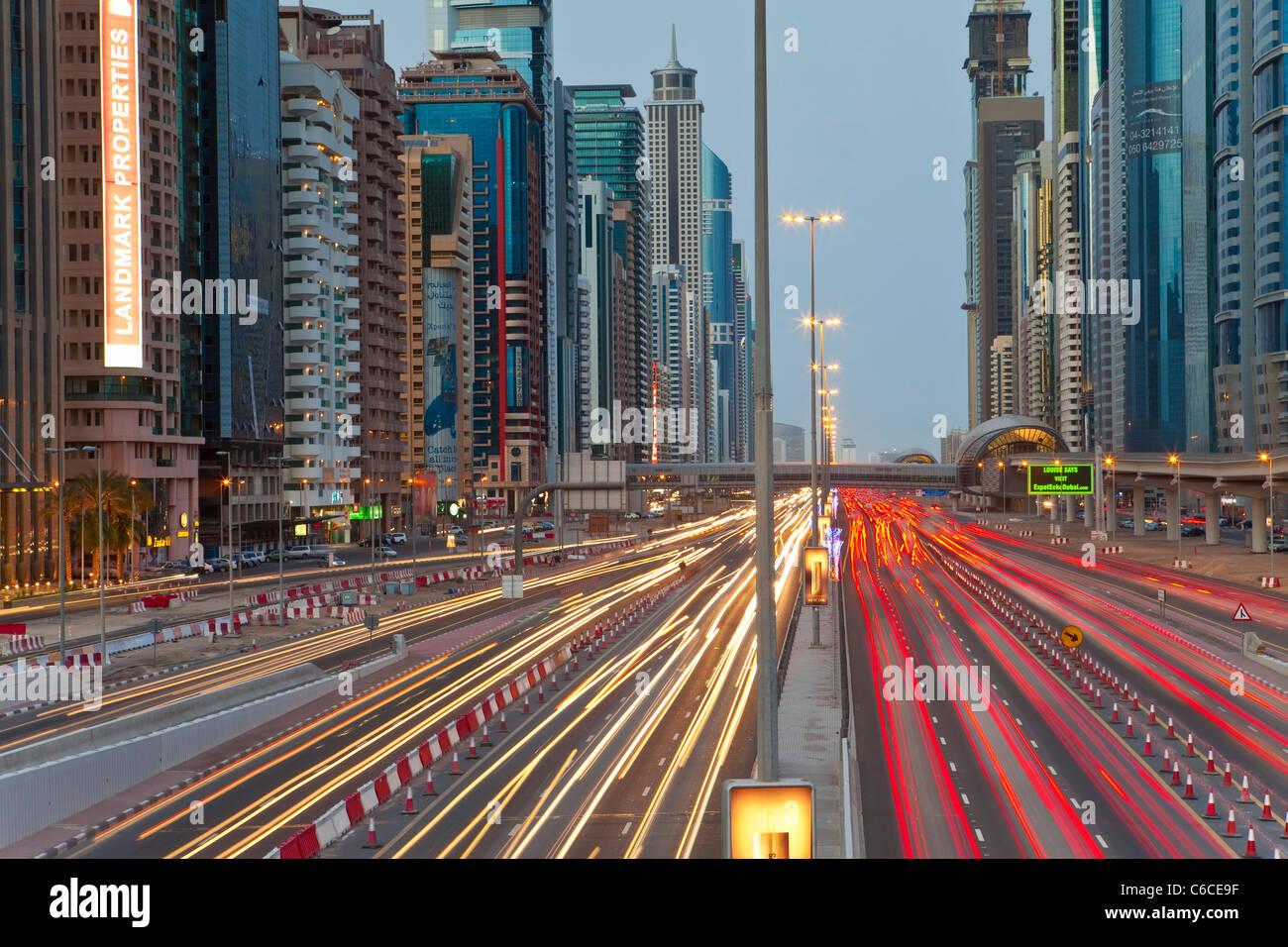 United Arab Emirates, Dubai, Sheikh Zayed Road, traffic and new high rise buildings along Dubai's main road - Stock Image