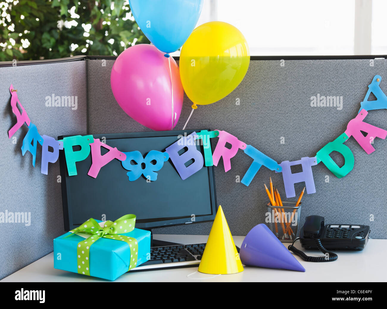 office birthday decorations. usa, new jersey, jersey city, close up of birthday decorations on office desk o