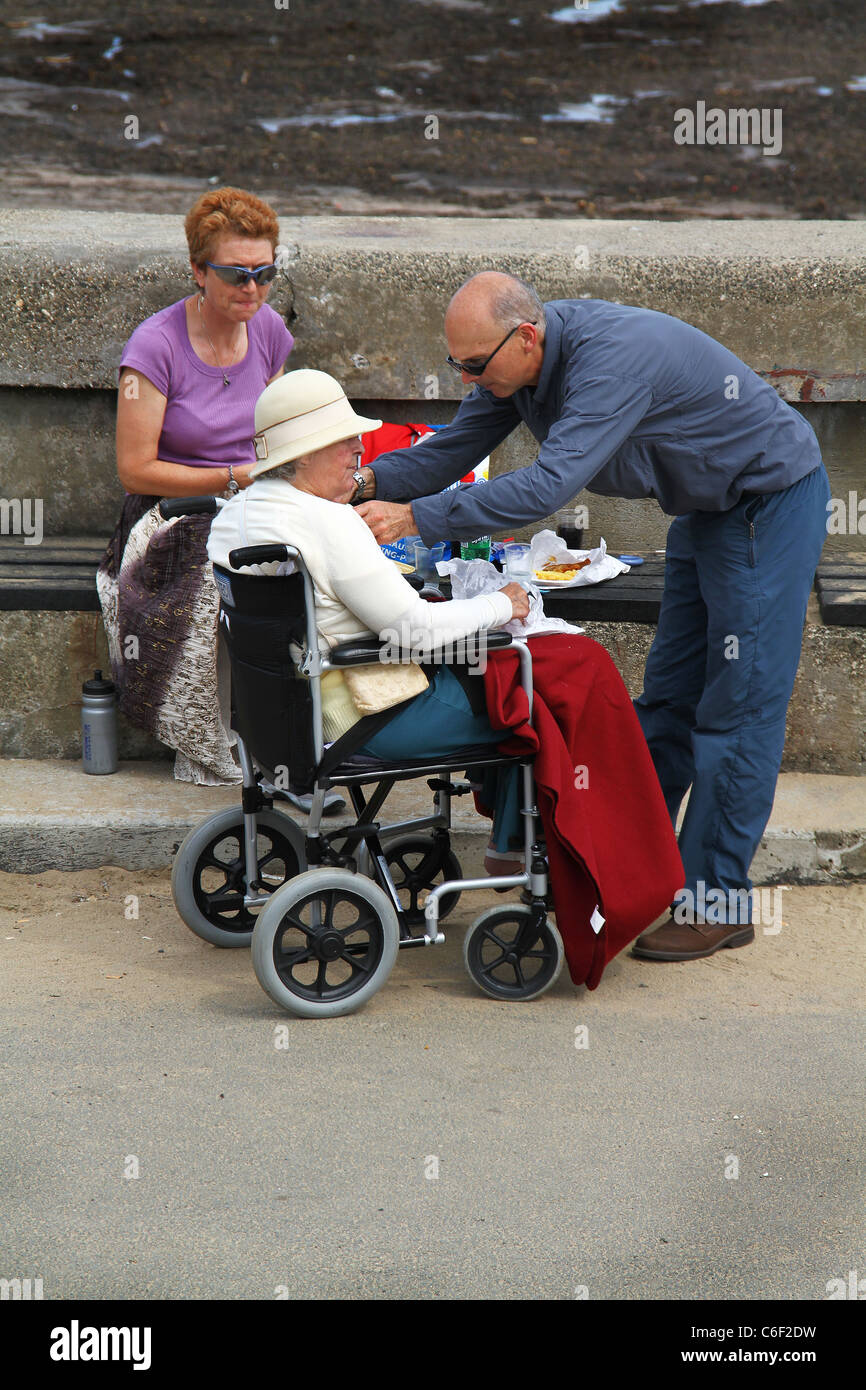 Image of: Disabled Es19 People Attending Old Lady In Wheelchair At Seaside Aliexpress People Attending Old Lady In Wheelchair At Seaside Stock Photo