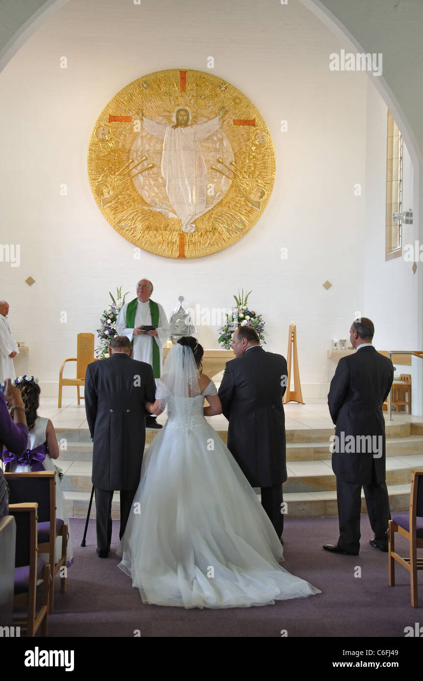 Wedding Ceremony In Modern Church Langley Berkshire England Stock