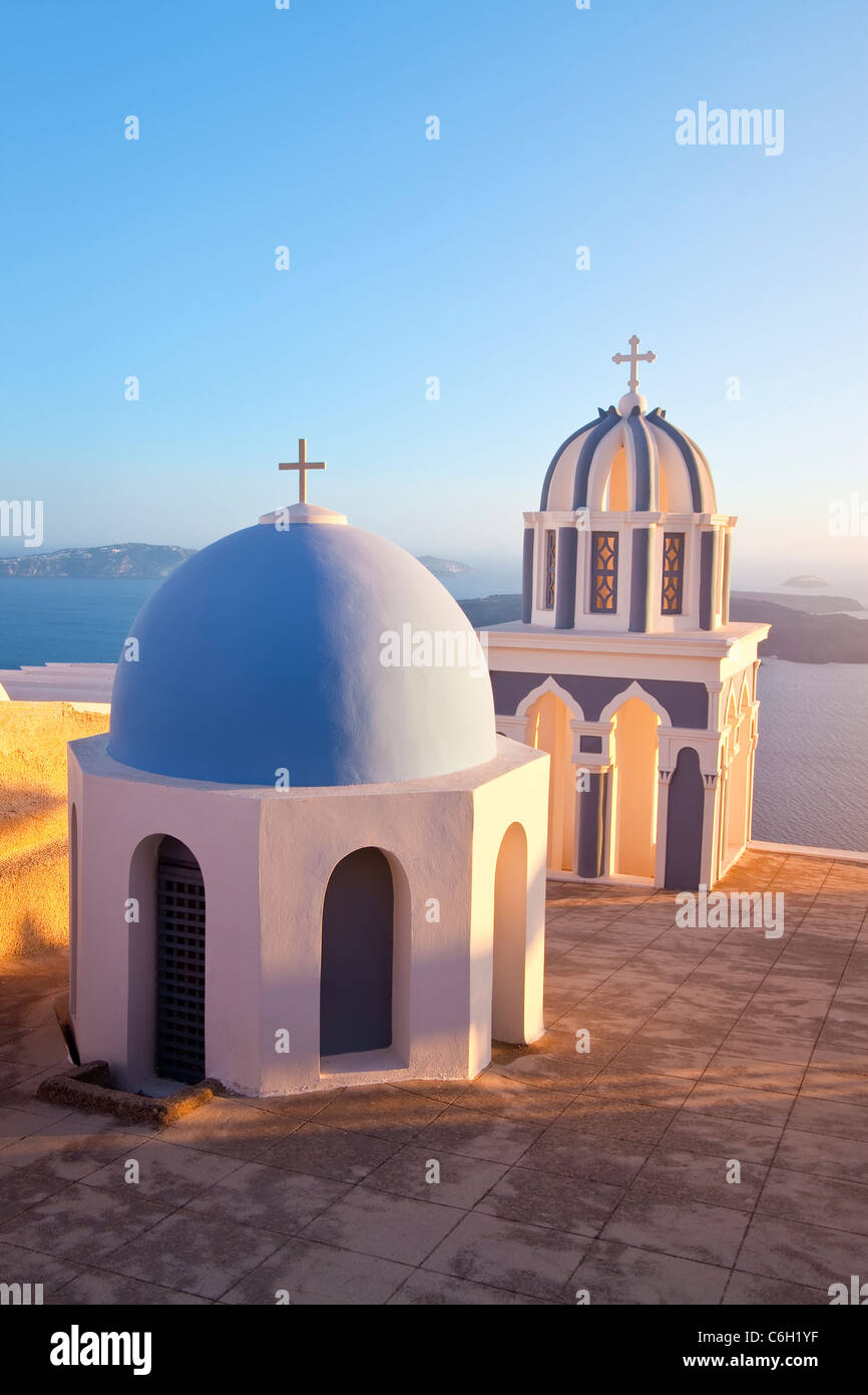 Bell Towers of Orthodox Church overlooking the Caldera in Fira, Santorini (Thira), Cyclades Islands, Aegean Sea, - Stock Image