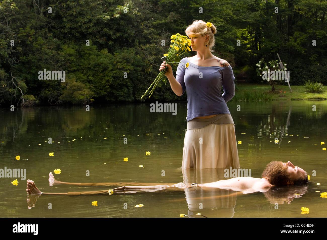 Woman Standing Over Man Man Lying Dead Stock P...