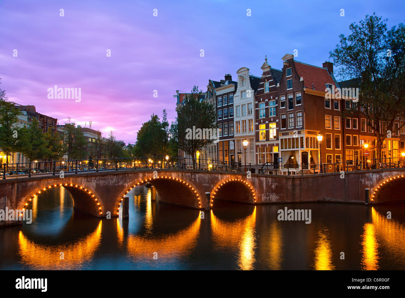 Europe, Netherlands, Keizersgracht Canal in Amsterdam at Dusk - Stock Image