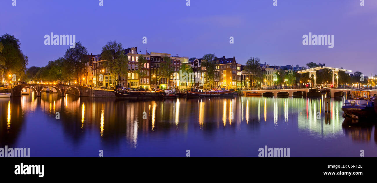 Europe, Netherlands, Amsterdam, Amstel Canal and Magere Brug at Dusk - Stock Image