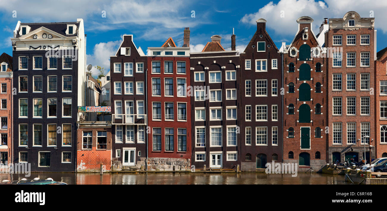 Europe, Netherlands, Amsterdam, Row Houses along the Canal - Stock Image