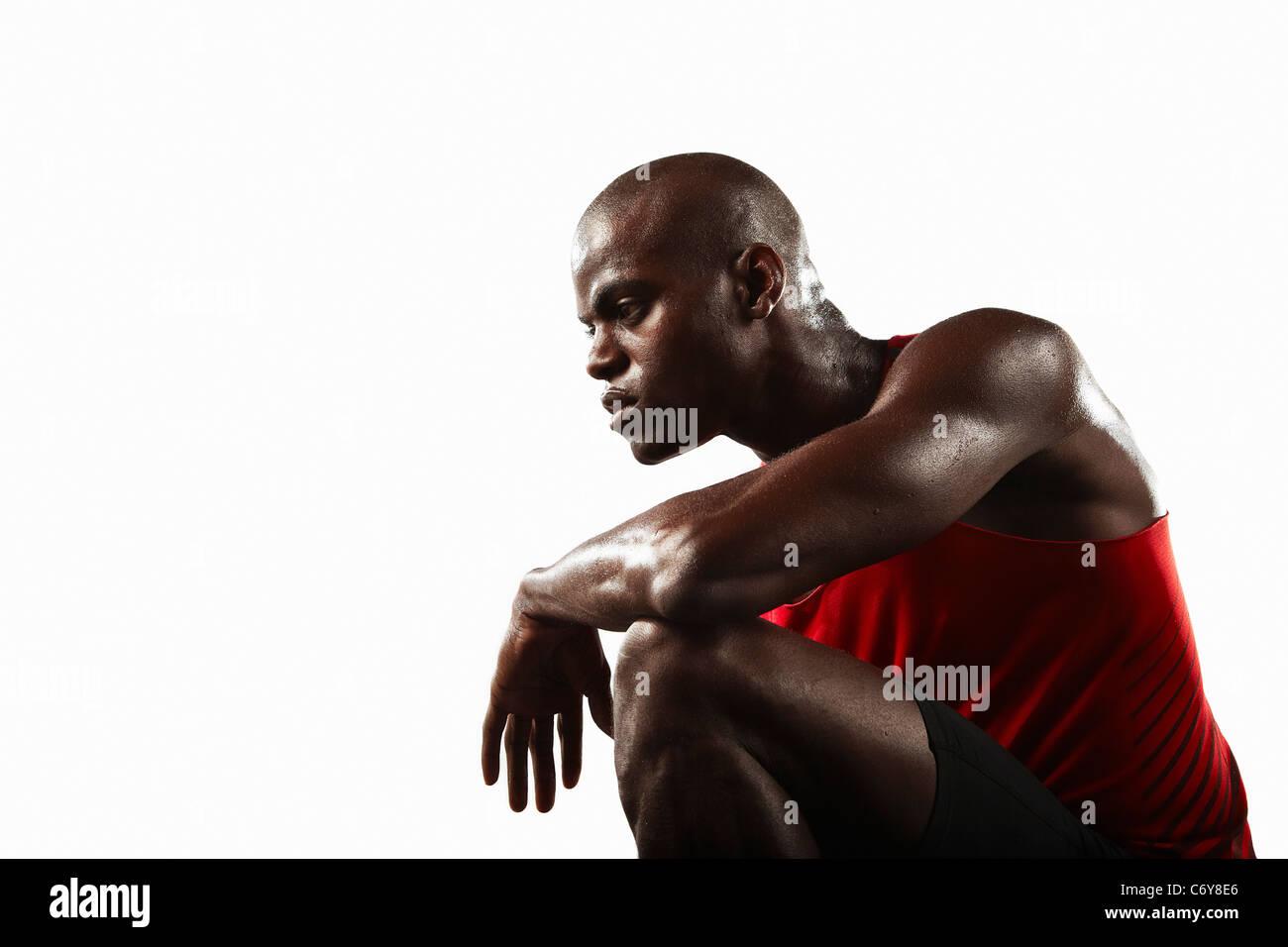 Athlete crouching - Stock Image
