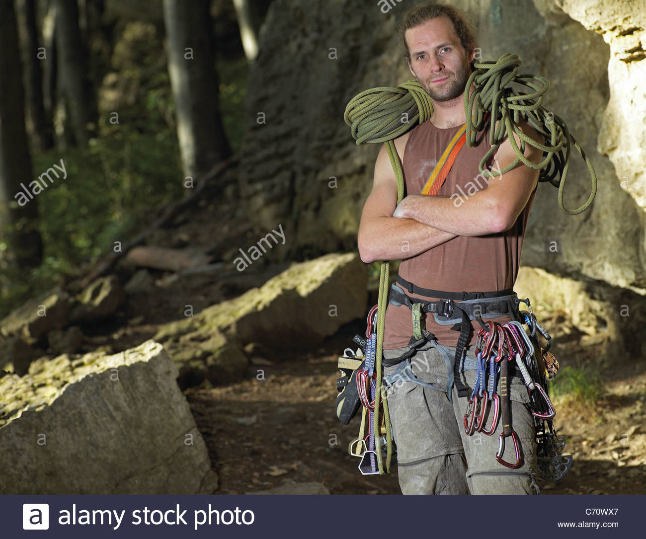 Rock climber with cords and belays - Stock Image