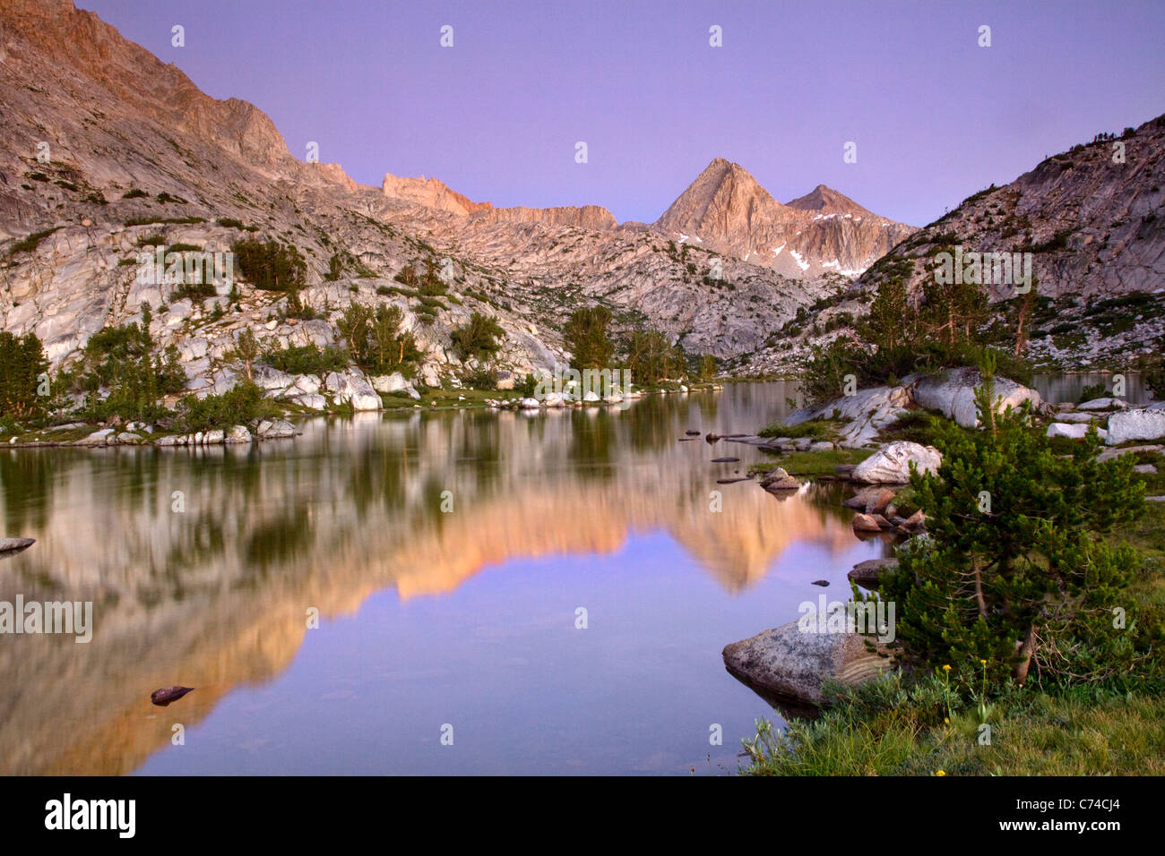 Reflection of a mountain range in a lake in California at sunset. - Stock Image