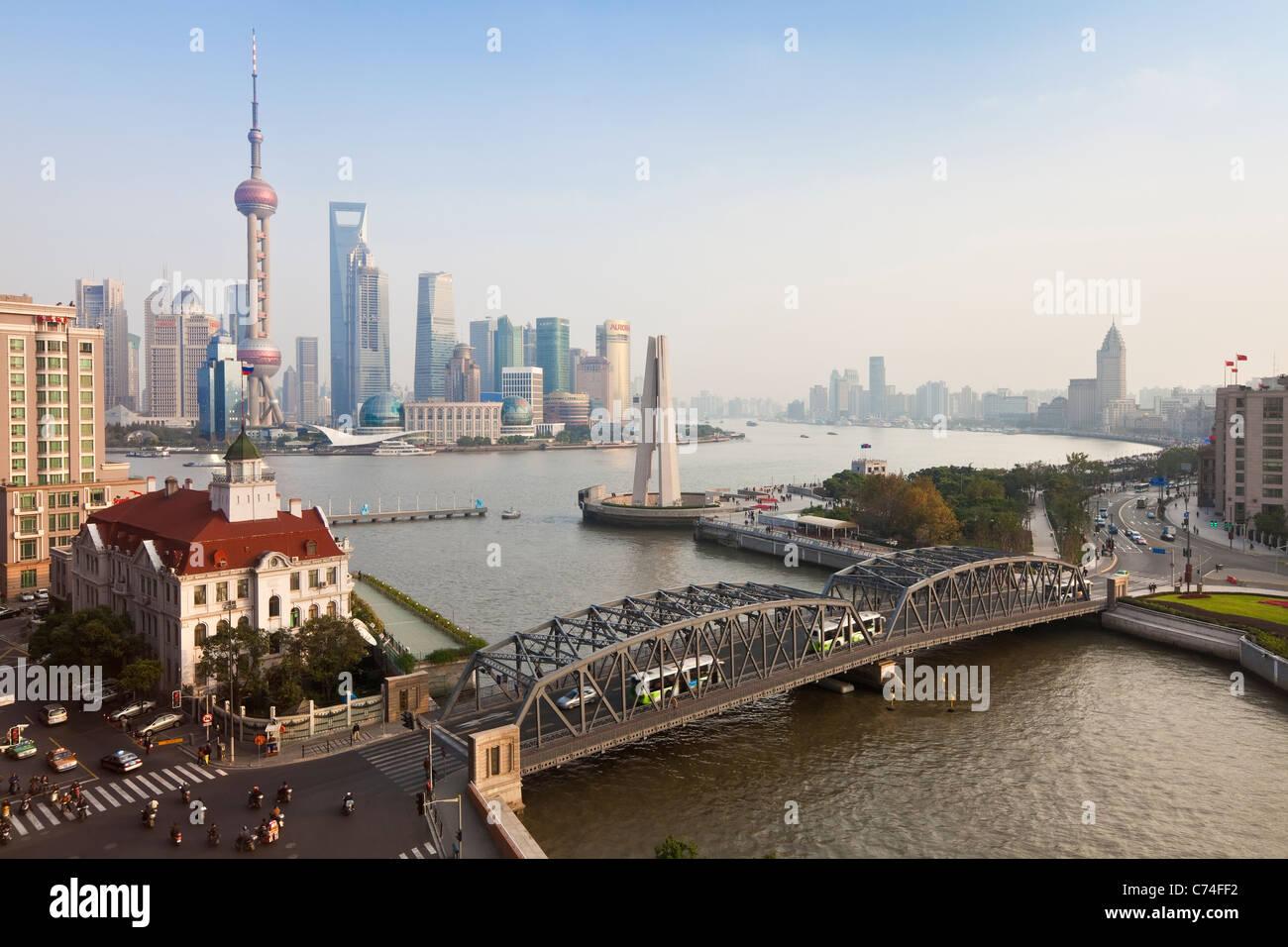New Pudong skyline Waibaidu (Garden) Bridge looking across the Huangpu River from the Bund Shanghai China - Stock Image