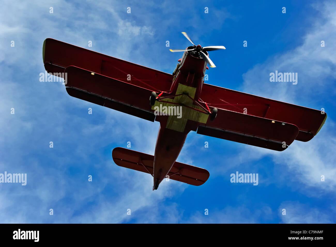 An Antonov AN-2 biplane landing. - Stock Image