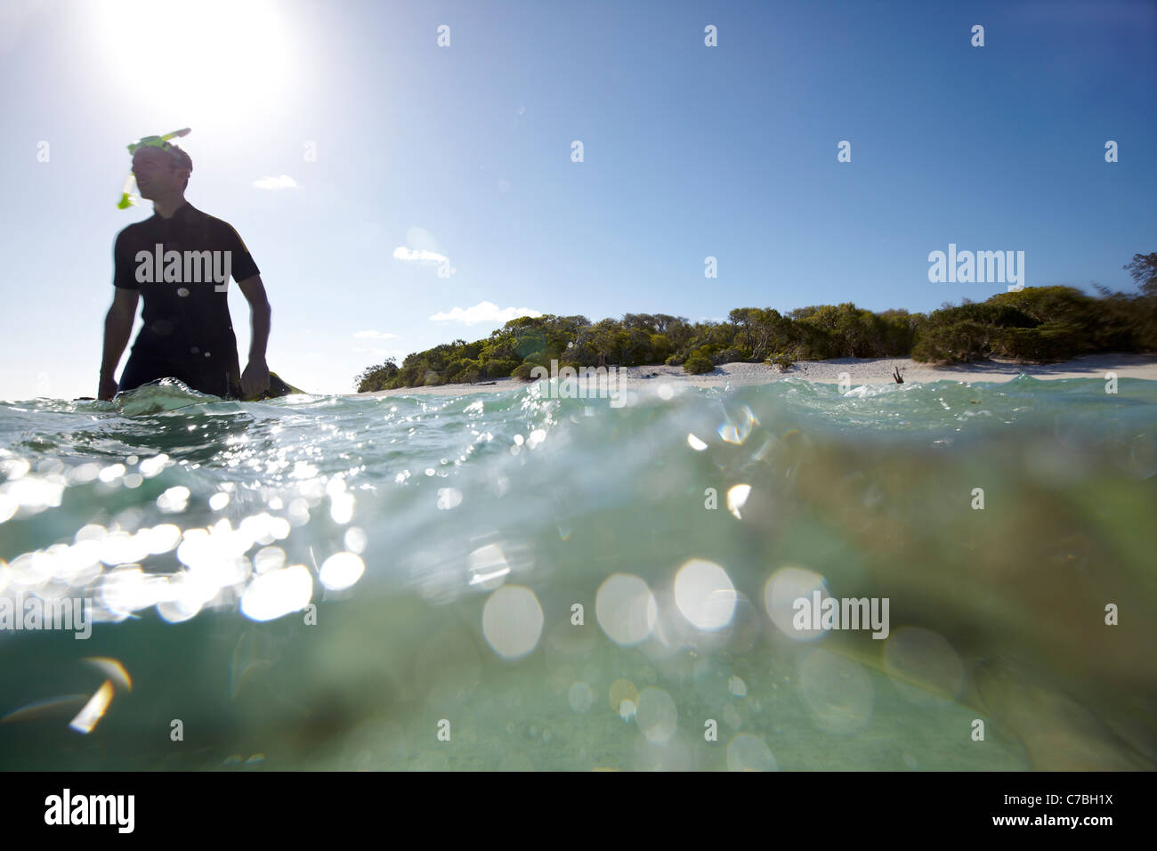 Snorkeler near Heron Island eastern part is part of the Capricornia Cays National Park Great Barrier Reef Marine - Stock Image