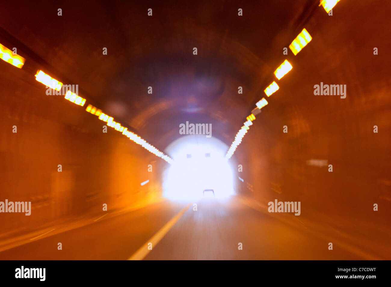 blurred motion tunnel like driving drunk metaphor with light at the end - Stock Image