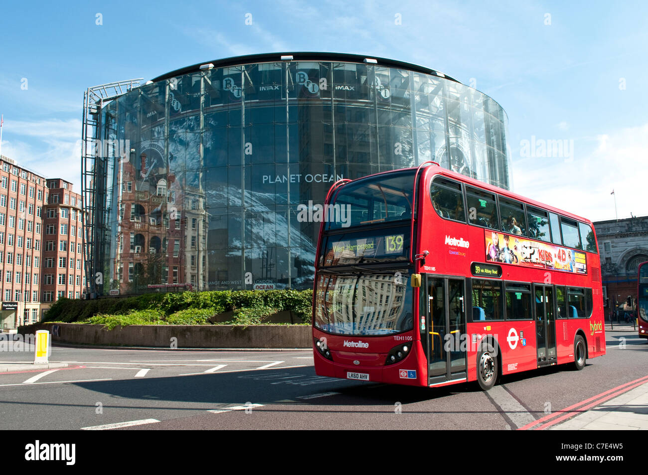 BFI IMAX cinema and red bus going to West Hampsted, London, England, United Kingdom - Stock Image