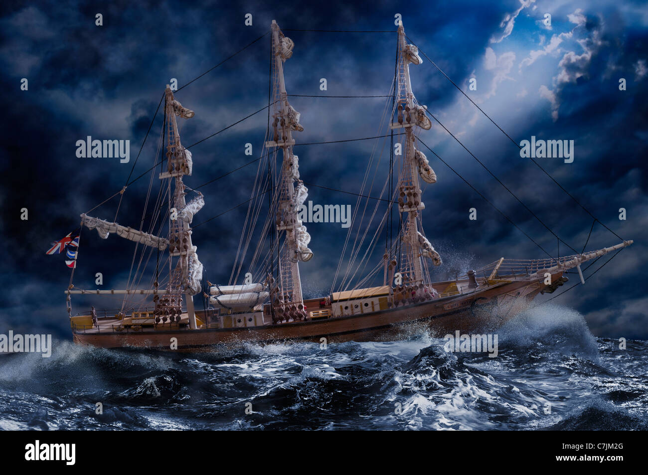 Ornate ship on stormy ocean - Stock Image