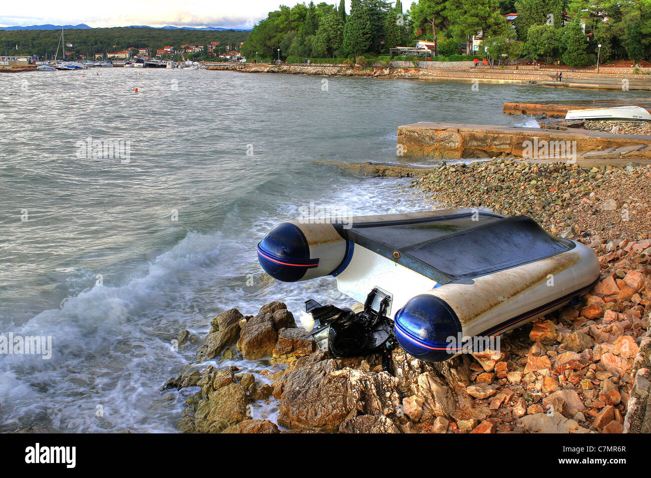 Boat crashed on the rocks sea shore after strong storm, Malinska, croatia - Stock Image