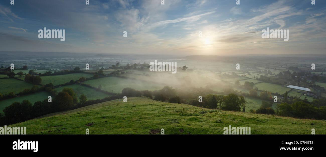 The Somerset Levels from Glastonbury Tor, soon after sunrise on Autumn Equinox. Somerset. England. UK. - Stock Image