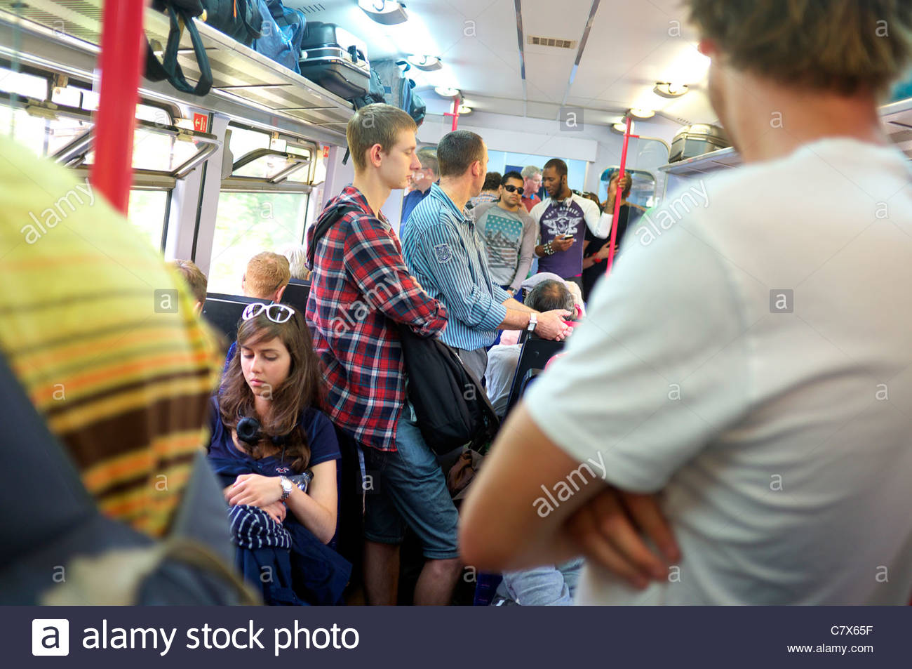 British railway carriage overcrowded with young people during a summer's journey, in Devon, UK. Stock Photo