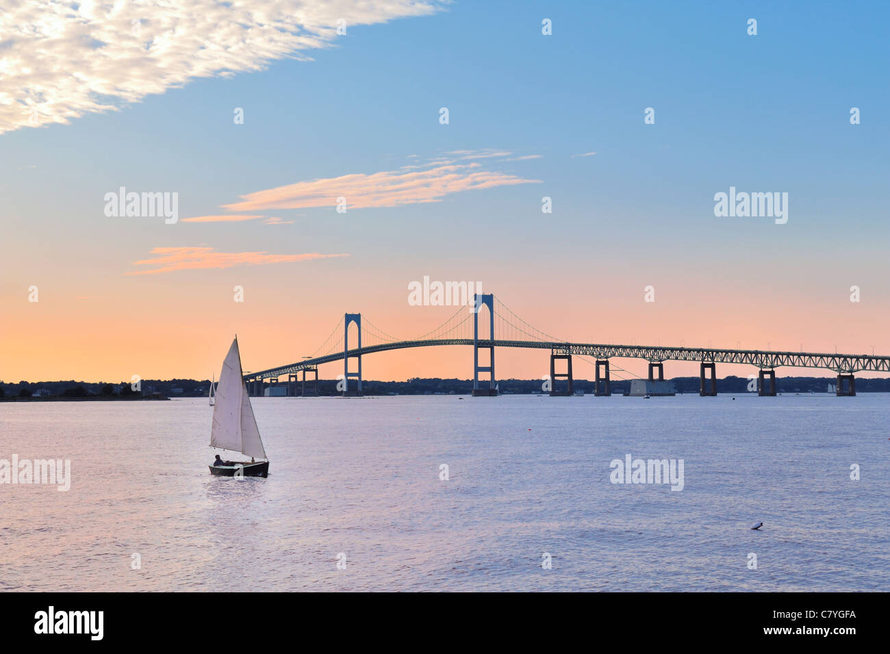 newport-sunset-with-newport-bridge-sailboats-newport-rhode-island-C7YGFA.jpg
